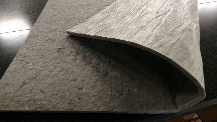 Spilltration® Husky material on a PolyBack rug