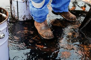 Worker Cleaning Up Oil Spill Outdoors